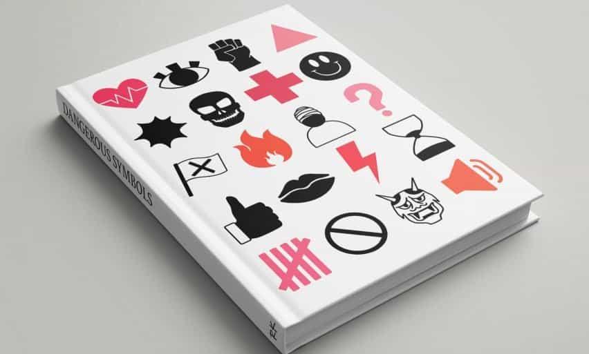 Un libro de diseño gráfico con varios símbolos en su portada