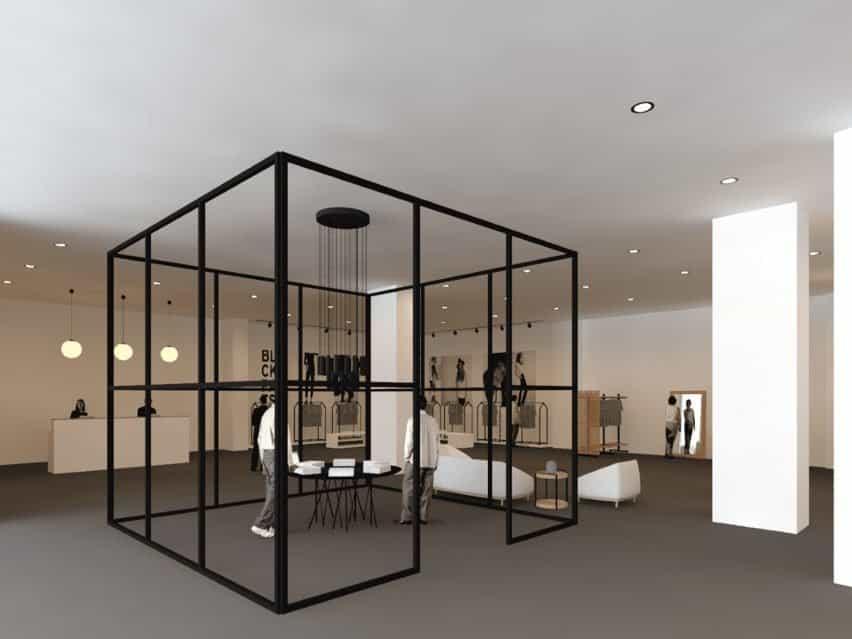 Un café basado en diseños europeos. Tiene una estructura negra en forma de caja con productos neutros.