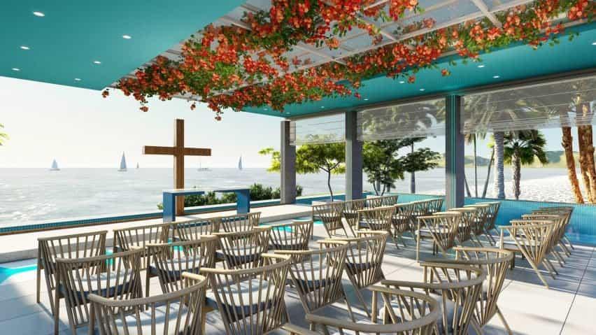 Un restaurante con flores naranjas en el techo.
