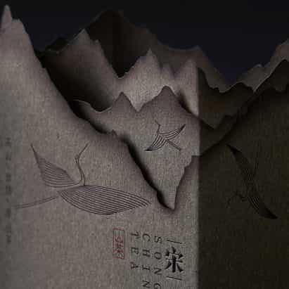 Lin Shaobin emula escenas montañosas con papel quemado para el envasado de té chino